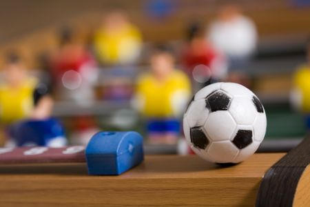 playing tabletop soccer with red and yellow figures
