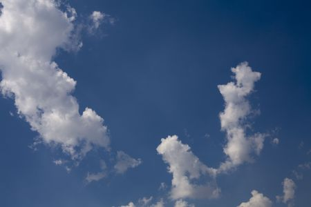 Formation of clouds with deep blue sky