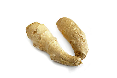 Ginger root on white background photo