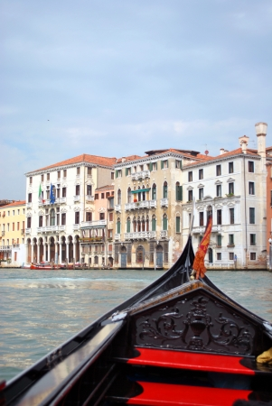Gondola ride on Grande Canal in Venice, Italy photo