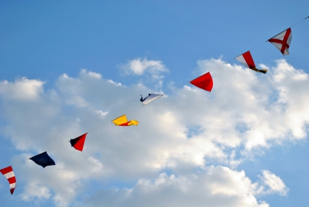 Nautical flags hanging against a blue sky photo
