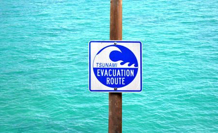 Tsunami Evacuation Route Signage with water in the background