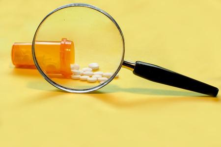 Opioid Crisis - Open Bottle of Prescription Painkiller Pills