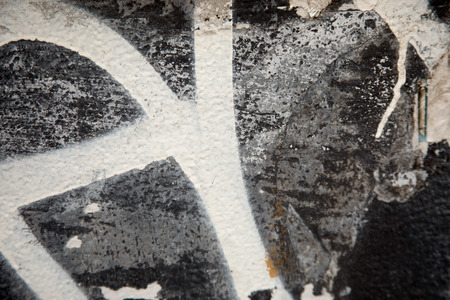 Closeup of gray and white urban graffiti wall