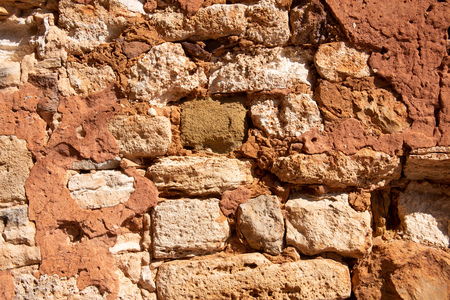 Stone wall dyed with ochre in Provence, France
