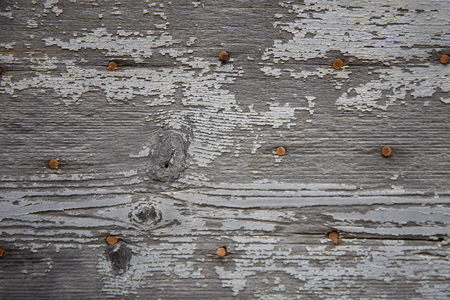Chipping painted wood background with nails