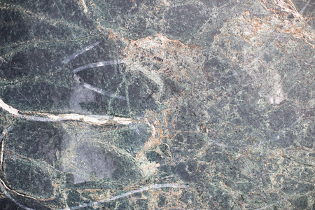 Closeup surface marble pattern of a stone wall texture background in earth tones Stock Photo