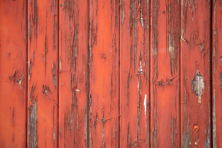 Close-up of chipping red paint on wood slats Stock Photo
