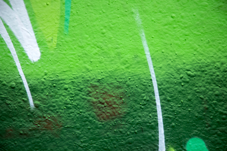 Close up of green paint on a cement wall, great background for designers