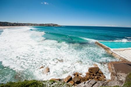 rocky coast and beach with blue sky