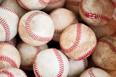 close up of old practice baseballs