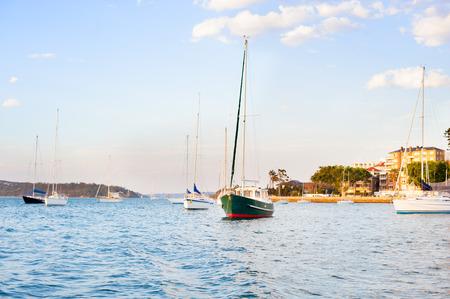 sail boats in the harbor at sunset Reklamní fotografie