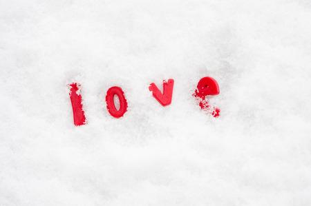 The word love in winter snow Reklamní fotografie