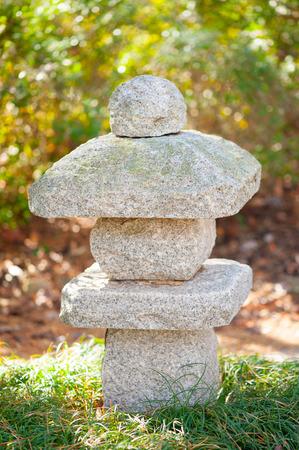 Japanese rock sculpture in a spring garden Reklamní fotografie