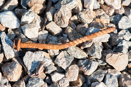 close up of rusted railroad spike