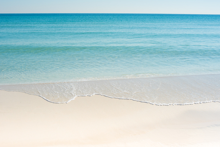 white sand beach with blue green water and waves Reklamní fotografie