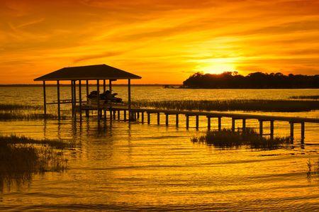ボートハウスの日没 写真素材