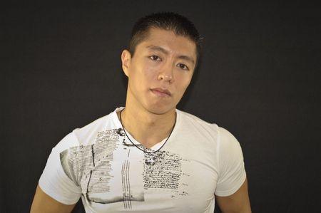 Asian Male on Black Background Stok Fotoğraf