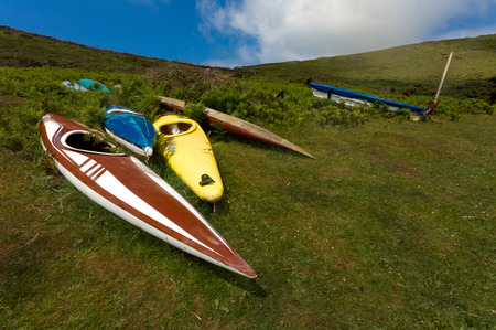 fibreglass: Old broken abandoned canoes left on the Gower peninsular Swansea.