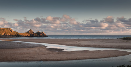 is well known: Three Cliffs Bay Swansea Well known landmark and beautiful beach in Gower, south Wales. Stock Photo