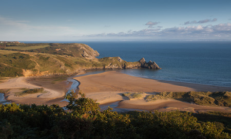 Three Cliffs Bay Gower Famous coastal landmark and beautiful beach in Gower, south Wales.