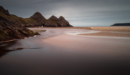 is well known: The river at Three Cliffs Bay Well known landmark and beautiful beach in Gower, south Wales.