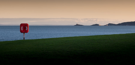 devise: Swansea bay with a life saver and view of The Mumbles