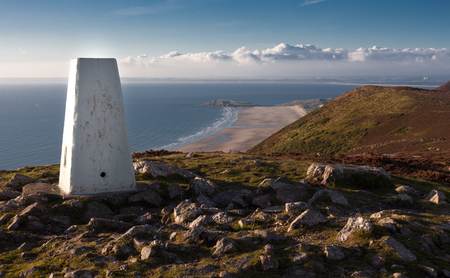 Trig Point on Rhossili Down Official name Rhossili Down SN41T18, 193 metres above sea level with amazing views of Rhossili Bay, South Wales Stock Photo