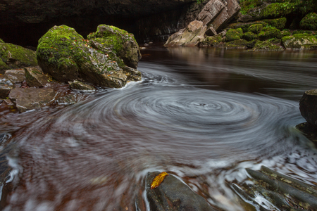 spiraling: Spiraling froth on the River Mellte at the entrance to Porth yr Ogof caves in Brecon, South Wales