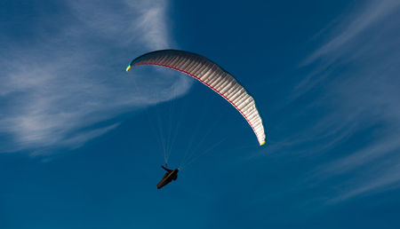 glide: Paragliding from Rhossili Downs on the Gower peninsular, south Wales. Stock Photo