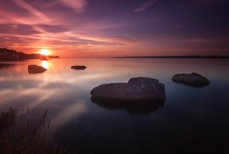 streaking: Sunset at Penclawdd on the Loughor Estuary, north Gower, Swansea. Stock Photo