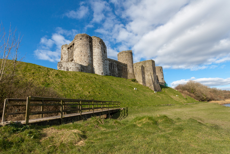 norman castle: Kidwelly Castle is a Norman castle overlooking the River Gwendraeth and the town of Kidwelly, Carmarthenshire, Wales.