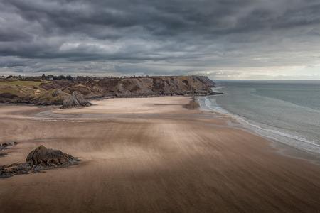 swept: Wind swept Three Cliffs Bay, a well known coastal beauty spot in South Gower, Swansea.