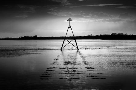 estuary: Cardinal marker on The Loughor Estuary  Sailing marker on The Loughor Estuary, Llanelli, South Wales.