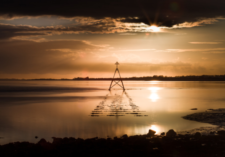 estuary: Sunset and Cardinal Marker at The Loughor Estuary, Llanelli, South Wales.