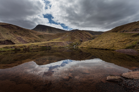 beacons: Llyn y Fan Fach Reflection Part of the Brecon Beacons in South Wales, near the village of Llanddeusant, the Welsh name means Lake of the small beacon hill