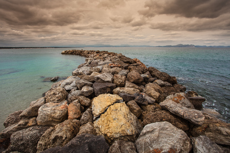 pinar: The breakwater at San Pedro Beach in Betlem, Mallorca, looking over Alcudia Bay towards Cap des Pinar and Cap de Formentor.