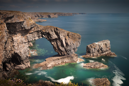 pembrokeshire: The Green Bridge of Wales, one of the UKs sea arches, one of the most spectacular sites on the Pembrokeshire Coast near Castlemartin. Editorial