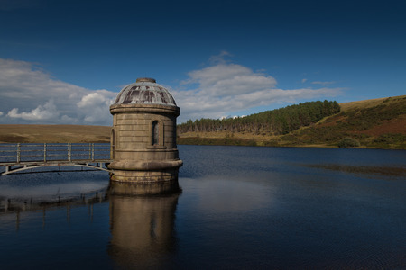 The Upper Lliw Valley Reservoir which is surrounded by a mosaic of habitats including bracken, scrub broadleaved woodland and wildlife.