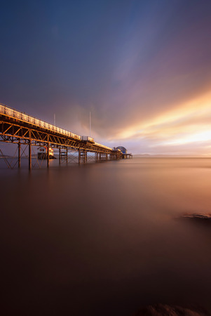 lifeboat station: Sunrise at Mumbles Pier showing the old and new lifeboat stations, Swansea