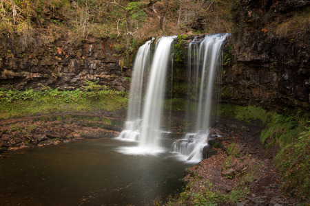 The Afon Hepste river plunges over a band of resistant gritstone to form the waterfall Sgwd yr Eira which translates into Fall of snow and often refered to as the waterfall you can walk under.