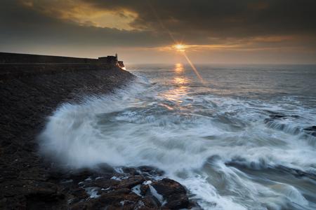 choppy: Dawn at Porthcawl Sunrise and a choppy sea at Porthcawl lighthouse in South Glamorgan, South Wales