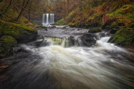 The Afon Hepste river plunging over a band of resistant gritstone to form the waterfall Sgwd yr Eira which translates into Fall of snow and often refered to as the waterfall you can walk under.