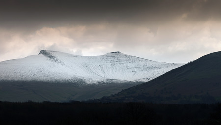 The snow covered peaks of Pen y Fan and Corn Du on the Brecon Beacons, the highest peaks in South Wales.