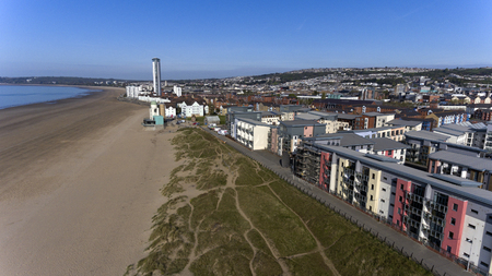 Editorial SWANSEA, UK - APRIL 19, 2017: An aerial view of the new coastal housing and the Meridian Tower at the marina sea front area of Swansea Bay, South Wales