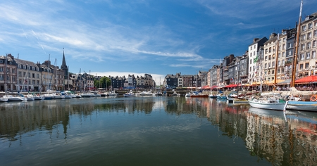 Honfleur harbour France Editorial Honfleur, France - July 05, 2017: Honfleur harbour in Frances Normandy region, sited on the estuary where the Seine river meets the English Channel