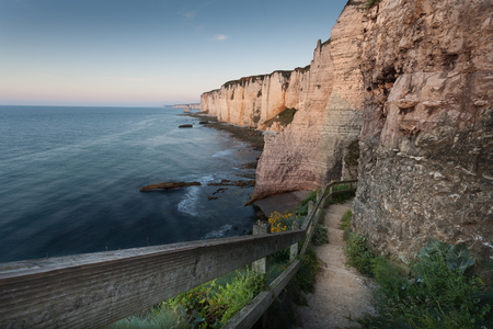 normandy: The walkway down to the pebble beach the other side of Porte d'Amont at Etretat, Normandy, France