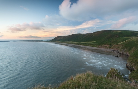 Editorial Swansea, UK - July 23, 2017: Rhossili Bay at the far tip of the Gower peninsula, showing The Old Rectory, possibly the most photographed house in Wales, UK Stock Photo