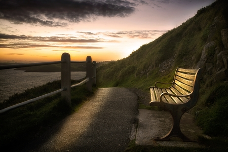 Wales Coastal Path bench A welcome break provided by a bench along the Wales Coastal Path between Mumbles and Langland on the Gower peninsula in Swansea, UK