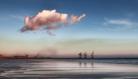 Tata Steel Plant at Port Talbot emitting fumes and pollution, photographed from the Aberavon beach, popular with surfers, South Wales, UK Reklamní fotografie